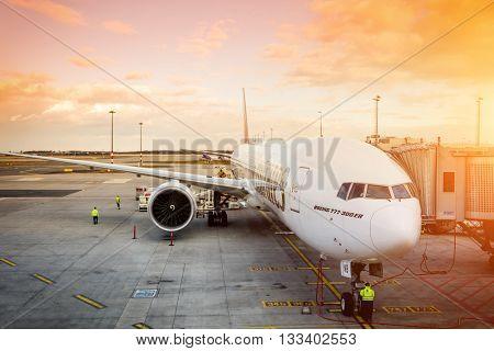 PRAGUE - April 7, 2016: Emirates Boeing 777-300 ER at Vaclav Havel Airport Prague on April 7, 2016, boarding passengers in beautiful sunset