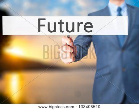 Future - Businessman Hand Holding Sign