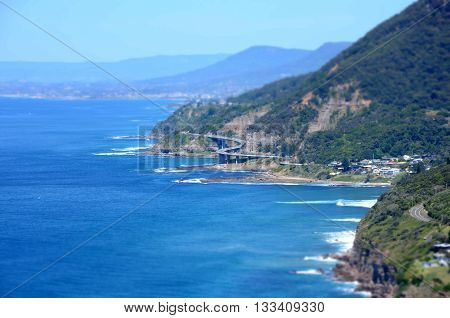 Panoramic view from Otford Lookout. The Sea Cliff Bridge is a balanced cantilever bridge.