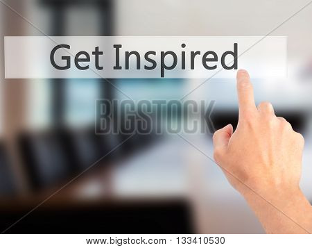 Get Inspired - Hand Pressing A Button On Blurred Background Concept On Visual Screen.