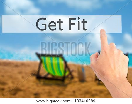 Get Fit - Hand Pressing A Button On Blurred Background Concept On Visual Screen.