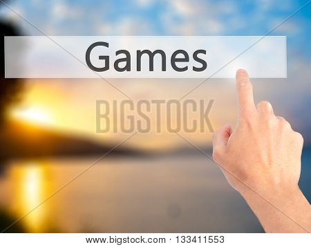 Games - Hand Pressing A Button On Blurred Background Concept On Visual Screen.