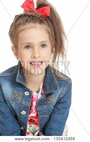 Closeup little girl in a denim jacket with a red bow on his head - Isolated on white background