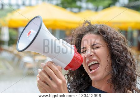 Attractive Angry Woman Shouting Into A Megaphone