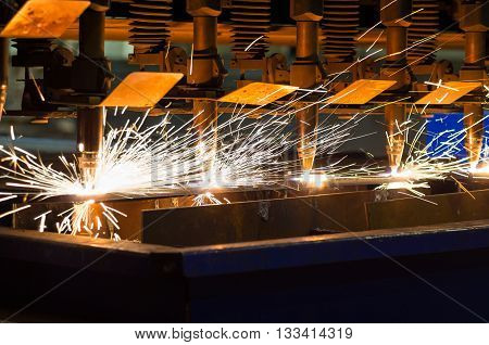 CNC LPG starts to cut sheet metal, flashes and sparks.