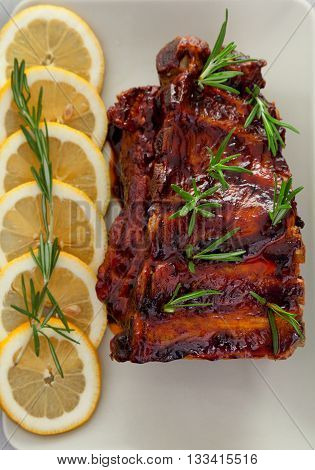 Slow cooked pork ribs with rosemary. Shot from above
