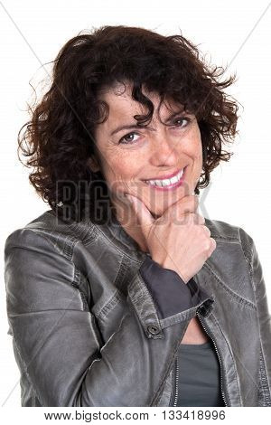 Middle Aged Woman Holding Her Finger On Her Chin. Isolated On White Background