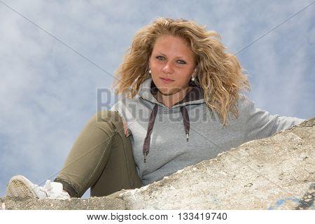 Blonde Woman Smiling Posing Under Blue Sky
