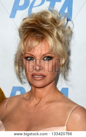 LOS ANGELES - JUN 7:  Pamela Anderson at the Peta Celebrates Prince on his Birthday at the Peta's Bob Barker Building on June 7, 2016 in Los Angeles, CA