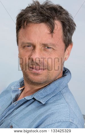 Handsome Middle Aged Man Smiling At The Beach Smiling
