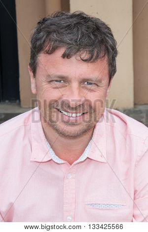 Portrait Of Handsome Guy Wearing Pink Shirt
