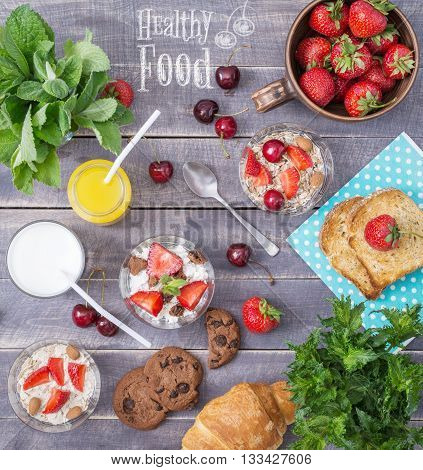 Healthy Breakfast Top View. Cereal with Milk and Strawberry on Wooden Table. Healthy Lifestyle Concept. Rustic Cover Menu.