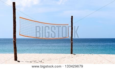 Volleyball net at beach. A volleyball net on beach with blue sea clear and sunny sky.