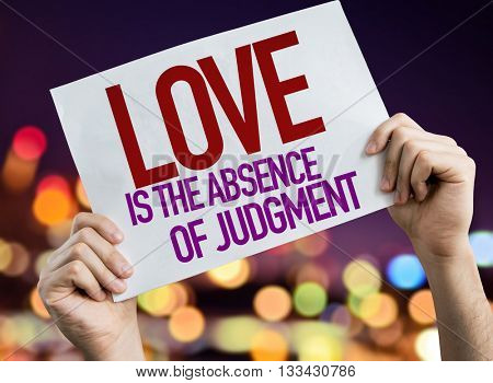 Love is the Absence of Judgment placard with night lights on background