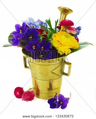 Fresh flowers in vintage mortar isolated on white background