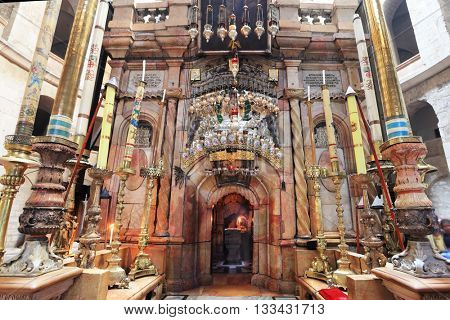 JERUSALEM, ISRAEL - MARCH 9, 2012: Church of the Holy Sepulcher in Jerusalem. Beautifully decorated with pink marble entrance Edicule, where the candle burns