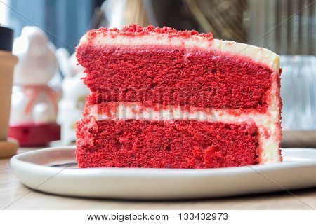 Piece of red velvet layer cake with cream cheese frosting