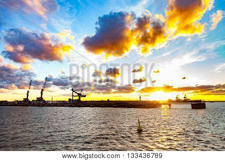 Sea port cranes at sunset in Port of Gdansk Poland.