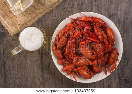 plate of boiled crawfish on wooden surface