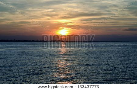 sunset over the sea in summer in Italy