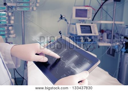 Doctor with advanced equipment in hospital ward.