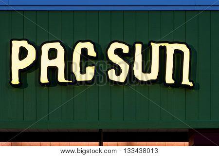 Oshkosh WI - 5 June 2016: Pac Sun store sign illuminated at night