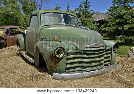 HAWLEY, MINNESOTA, June 6, 2016:  The old pickup from the 40's is a Chevrolet, colloquially referred to as Chevy and formally the Chevrolet Division of General Motors Company, is an American automobile division of the American manufacturer General Motors