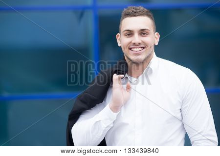 Portrait Of Young Cheerful Businessman Smiling At Camera