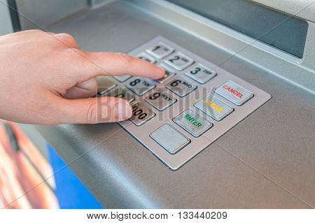 Person Is Using Keypad And Entering Pin Code In Atm Machine. Ban