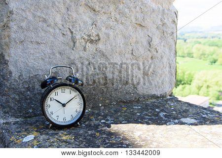 Alarm Clock On The Stone Wall