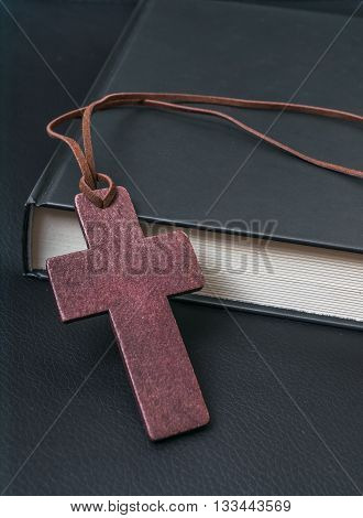 Theology Concept. Wooden Cross Next To Holy Bible.
