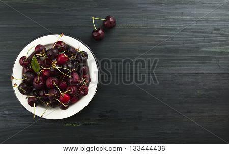 Fresh Sweet Cherry On A Dark Wooden Background