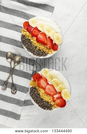 Healthy Breakfast Of Smoothie With Chia, Coco, Strawberry, Nuts And Banana On A White Background. To