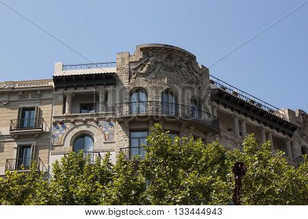 Balconies in old houses of Barcelona. Spain