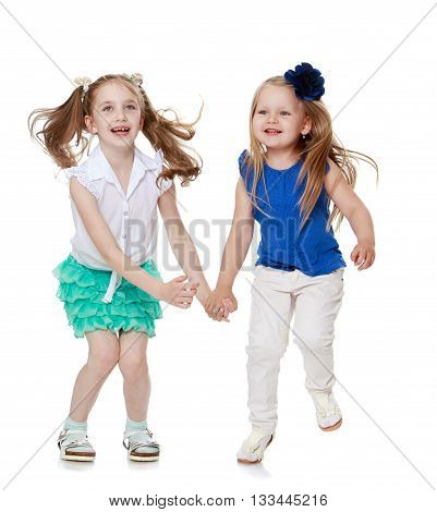 two funny little girls with long blond hair fun jump-Isolated on white background