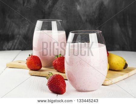 Milkshake With Strawberry And Banana In Glasses