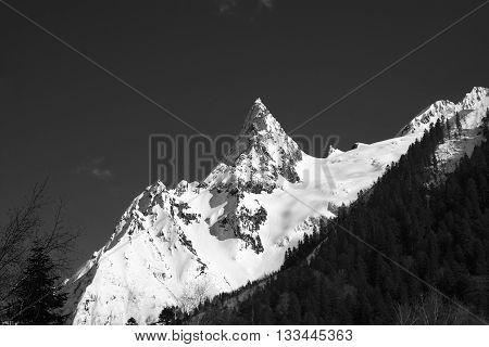 Black and white mountain peak in snow. Caucasus Mountains region Dombay peak Ine.