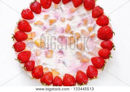 Cake dessert with strawberries gelly yogurt and cherries isolated on white background. Shot from above macro shot