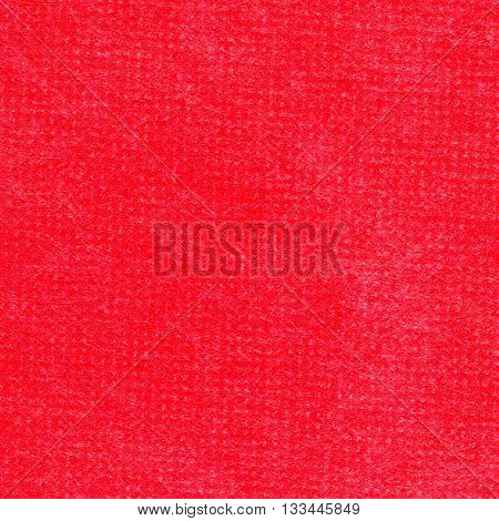 Blank piece of red paper as background. Close-up.