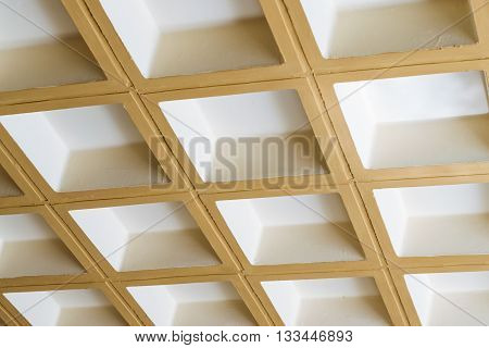 Modern white concrete ceiling of the square blocks in the constructivist architectural style 3D background stone texture from parallelepipeds. Bali Rethymno Crete Greece