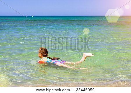 Girl Child Relaxing And Bathed On Cretan Sea, Bali, Crete