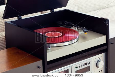 Stereo Audio Music Turntable Vinyl Record Player in Rack Closeup