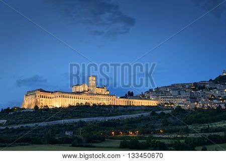 Illuminated cityscape Assisi basilica and monastery in Umbria Italy