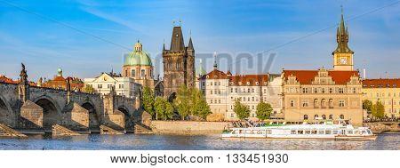 Prague, Czech Republic panorama with historic Charles Bridge. Boat cruise on Vltava river.
