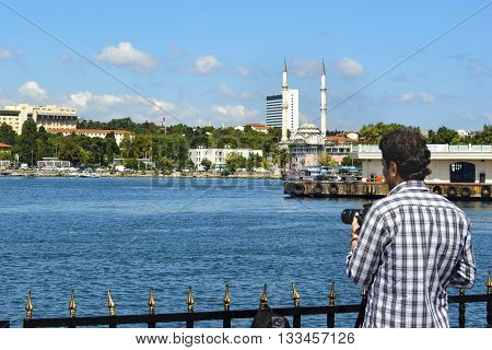 Istanbul Turkey - September 9 2012: Istanbul Kadikoy pier is getting attention of photographers. Protocol Haydarpaşa Mosque in the background.