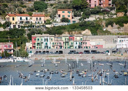 Portovenere Italy - September 19 2010: mussel farm beach and houses at the harbor