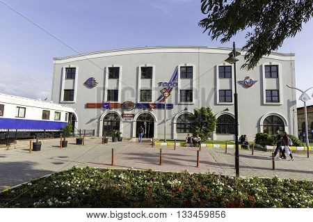 IZMIR TURKEY - APRIL 30 2016: Facade view of IZBAN Alsancak Train Station in Izmir. IZBAN sometimes referred to as Egeray is a commuter rail system serving Izmir Turkey.