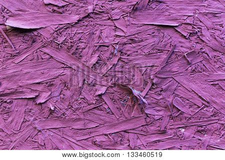 Pink colored recycled compressed hardboard wood chipboard