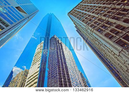 Bottom-up View Of Skyscrapers Reflected In Glass In Philadelphia