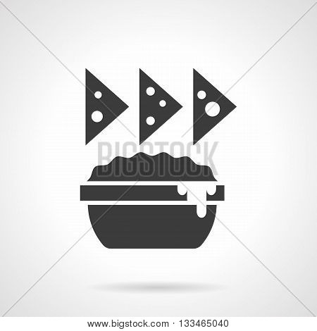 Monochrome silhouette of nachos and sauce dish. Chips, cheese appetizer menu. Mexican food. Symbolic black glyph style vector icon.